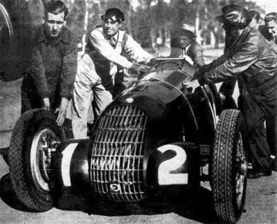 """Ricardo Nasi pushes to the starting grid of the 1939 """"La Plata"""" GP in Buenos Aires, his 308 # 50017. He battled the race with the 8C # 50014 Alfa Romeo of Carlos Arzani, who finally won the race."""
