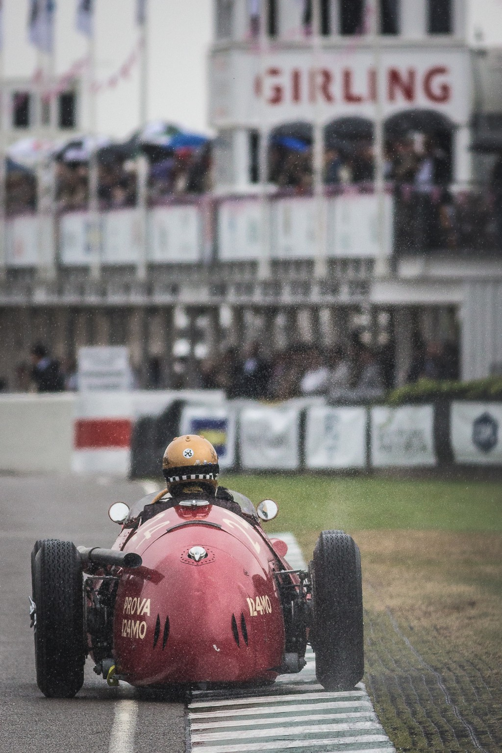 1955 Maserati 250F kicking up spray as it exits the final chicane