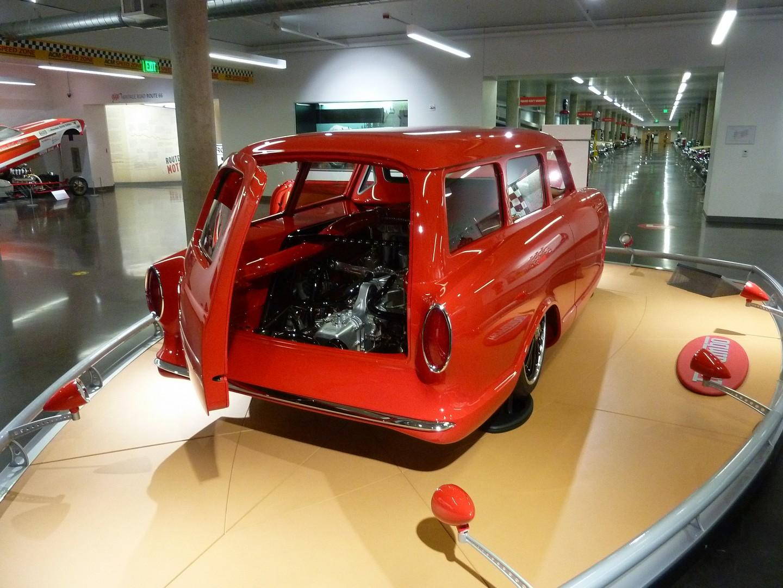 A red Ferrar-engine powered Rambler station wagon with rear door open