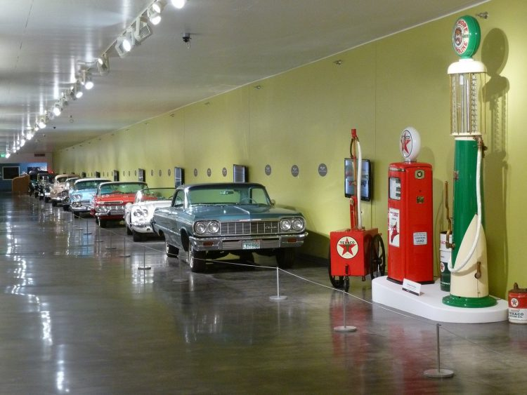 Vintage cars lined up along the wall for display