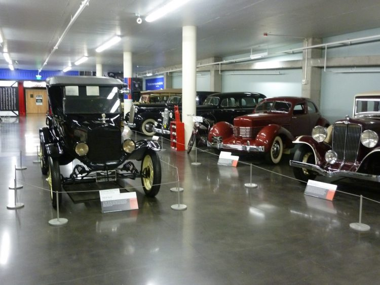 Vintage cars roped off at the Lucky's Garage exhibit in the LeMay Museum